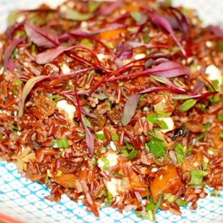 close up on red-colored stir fried vegetables with khorasan wheat